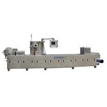 Machine de thermoformage alimentée par rouleau / pour emballage / automatisée / sous vide