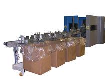 Système de remplissage de cartons / automatique