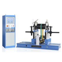 Machine à équilibrer à entraînement par courroie / horizontale / de rotor / pour essieux de chemin de fer