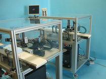 Cellule robotisée de test / de jauge / pour pièce en matière plastique
