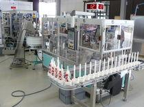 Machine d'assemblage automatique / pour lignes de Heparin