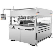 Machine d'enrobage de chocolat / pour l'agro-alimentaire