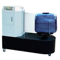 Banderoleuse à plateau tournant / automatique / de bagage / à film étirable