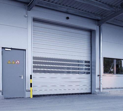 porte à enroulement / de hangar / industrielle / résistante au vent