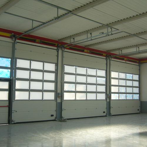 Portes sectionnelles / industrielles / pour l'intérieur / de hangar Tecnovision Tecnoindustriale s.r.l.