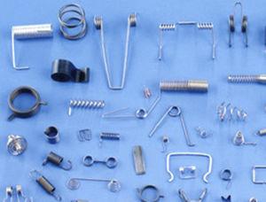ressort de compression / de torsion / de traction / à fil plat