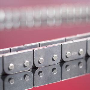 chaîne de transmission / à plaques déportées