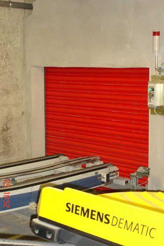 porte coulissante verticale / en métal / industrielle / coupe-feu