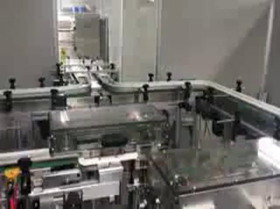 Machine de cartonnage de mouvement continu